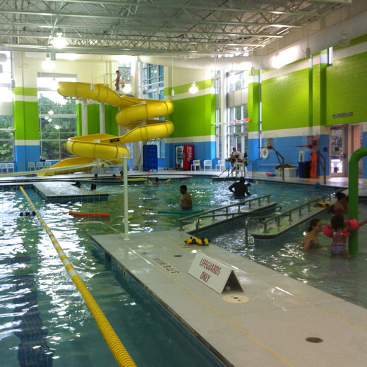 Buffaloe Road Aquatic Center with water slide, river, vortex, toddler area, volleyball and basketball